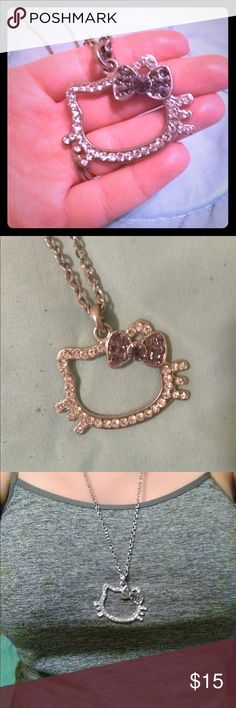 💟Hello Kitty pendant rhinestone necklace 💟 Super cute hello kitty rhinestone necklace. All rhinestones are in tact. Features a purple bow. Longer in length, please see pictures. Excellent condition. Message me if you have any questions and check out my other listings. Bundles and offers accepted ❤️ Hello Kitty Jewelry Necklaces