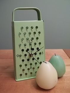vintage grater upcycled to a kitchen clock. $20.00, via Etsy.