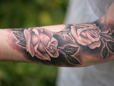 Rose tattoo designs ideas for men .Rose tattoo also portray their sincere divine emotions to God. Black Rose Tattoo For Men, Rose Tattoo On Arm, White Rose Tattoos, Rose Tattoos For Men, Arm Tattoos For Women, Tattoos For Guys, Lower Arm Tattoos, Unique Forearm Tattoos, Forearm Tattoo Design