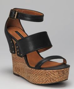Like the name implies, this stacked pair of sky-high wedges is ready to dance! The scale-printed cork heel with studded leather straps is sure to put a sassy sashay into every stylish step.