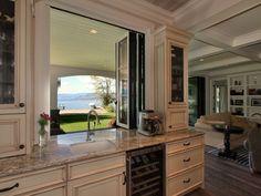 Kitchen window pass-through to patio. Love the folding window.