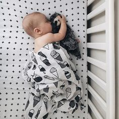 Peaceful naptime scenes with Modern Burlap's organic muslin Swiss Cross crib sheet and the adorable ice cream muslin swaddle blanket! Black and white goodness!