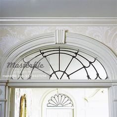 ARCHITECTURAL DETAILS: Transoms above door, leaded glass, white elaborate trim.