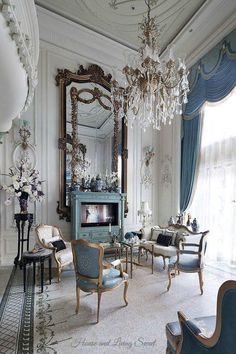 Design on the edge of the rug, chandelier, giant mirror and the outer frame, I like the look of the chairs but they don't look very comfy