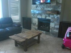 Chunky hand hewn / ax cut mantle from 1800s barn post is now in its new home.