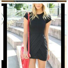Black mini Worn once. Mini can be worn day or night Dresses