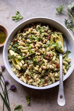 A simple, colorful pasta salad that's perfect for lunches, picnics, BBQ's, and easy dinners. Fresh pasta tossed with homemade basil vinaigrette, creamy goat cheese, sun-dried tomatoes, white beans, and finished with sliced avocado. This is a (mayo free) pasta salad that everyone will love.