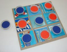 DIY Tic-Tac-Toe board using cereal box, water bottle caps, washers and magnets