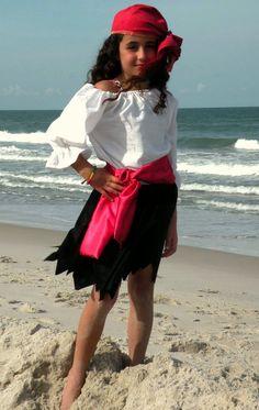 Easy pirate: billowy blouse, ripped black skirt, head scarf & sash