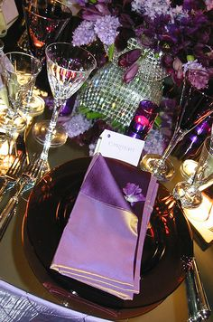 A silk napkin in two shades of purple adds extra depth to a violet-  themed place setting.