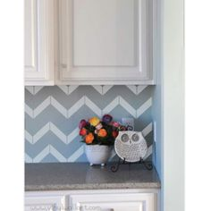 Chevron peel and stick. Totally doing this but not as backsplash- instead on the back of my glass kitchen cabinets.