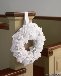 With their whispery petals and luminous silver centers, the tissue-paper flowers that bloom on this wintry wreath look as if they were plucked from a fairy tale. Perhaps more magical is the fact that this inexpensive pew decoration won't wilt or fade, so you can make as many as you need well ahead of time.