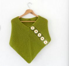 Green Ponc with Daisy Flowers, Wool Green Shawl Wrap, Holiday Fashion, Spring Poncho  This hand knit green poncho is embellished with crochet white daisy flowers. It keeps you warm in autumn/ winter season.  (My own original design - AOD)  Material: High quality soft acrylic wool mix yarn  Size: US 6 - 8 or UK 8 – 10, European 36 -38 For larger sizes please convo me.  **This item is made to order, please allow 6- 8 days from order to ship.**  As you see on the fifth picture you can combine…