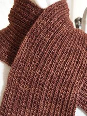 Simply Ribbed is just that—a simple ribbed knit scarf. Unlike a straight knit and purl rib there is a little twist that adds a bit of
