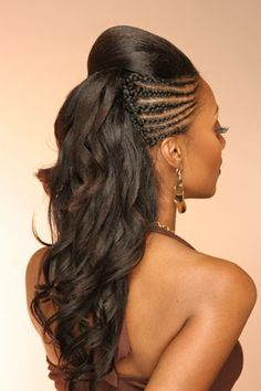 Dual hairstyles for 2014 black hair - Side cornrows with a top ponytail and long wavy cascading hair. Long black hairstyles 2014