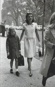 Jackie walking with Caroline, 1965