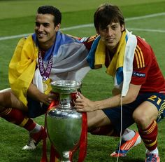 Spanish midfielder David Silva (R) and forward Pedro Rodriguez pose with the trophy after winning the Euro 2012 football championships final match Spain vs Italy on July 1, 2012 at the Olympic Stadium in Kiev.