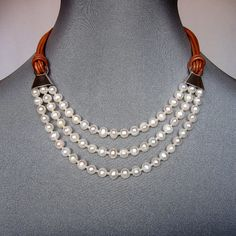 Pearls necklace. Leather and silver upscale designer jewelry.