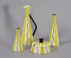 Cruet set and oil pourer by Clayburn Pottery