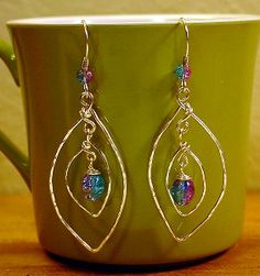 Put some energy into your accessories with this tutorial for Swingin' Leaves Wire Wrap Earrings. With this wire wrapping tutorial, you'll learn how to make earrings with lots of movement.