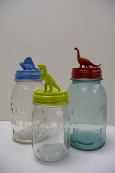 Three Storage Jars vintage Upcycled containers Hand painted lids DINOSAURS Colorful, whimsical organizers. $30.00, via MySeriousSide on Etsy.