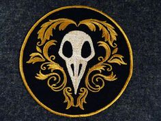 GerriTullis's ornate bird skull patch. Still looks like a plague doctor's mask to me...