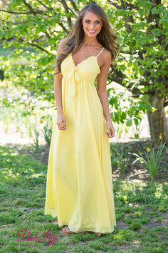 You'll definitely shine in this gorgeous new maxi dress! We adore the beautiful yellow color, front tie, and the ruffled look along the v-neck! Whether it's for a special day or a night on the town, this dress is perfect for you!