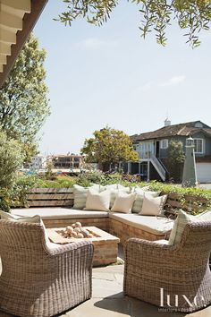 THE OUTDOOR SEATING  Landscape designer Molly Wood designed a built-in fire pit and banquette for a Newport Beach house.  Designers Erin Fli...