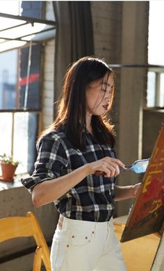 Yi Zhou is constantly creating. The multimedia artist draws inspiration for her art and her style from her home in China. #LiveInLevis