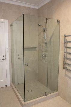 custom made frameless pivot shower screen by White Bathroom Co