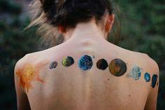 Solar System on girl's back.