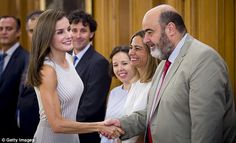 Queen Letizia of Spain shakes the hands of a guest at Zarzuela Palace in Madrid, revealing her honed arms at the same time