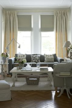 Roman Blinds in Plain Pigeon works especially well with curtains draping next to the blinds. This double approach of curtain with blind is great is a tall room