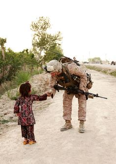 Shaking hands by U.S. Central Command (CENTCOM), via Flickr  A U.S. Marine stops to shake hands with a young girl while on patrol in Marjah, Afghanistan