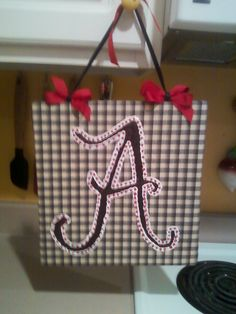 Alabama A painted with fabric paint on fabric covered board with ribbon to match