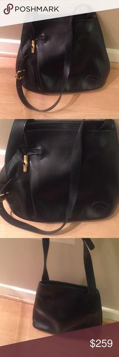 Longchamp black leather bag Black leather longchamp bag in excellent condition.Has pockets inside. Great condition and unique design. Longchamp Bags