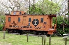 An old Illinois Central Gulf wooden caboose in Raymond, Mississippi. Odd door on side...