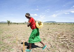 Maasai woman carrying a full water container. by Hugh Sitton - Stocksy United Water Issues, Water Containers, Kenya, Africa, The Unit, Stock Photos, Woman, Image, Afro