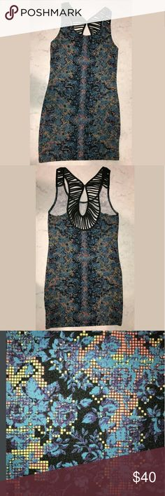 Free People Body Con Floral Pixel Snakeskin Dress New with tag Free People dress. Button tag attached, price tag fell off. Size small. Digital print. Black detail on shoulders and along back. Free People Dresses Mini