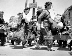 people return from China walk circa May 1946 in Fukuoka, Japan.