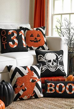 Scare up an entire haunted house full of compliments by casting a designer spell on your seating with our Halloween Hook Throw Pillows.