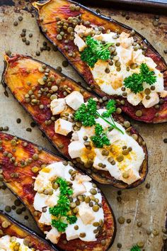 These Roasted Harissa Eggplant Halves make for a healthy and delicious dinner recipe that's gluten-free and dairy-free! Recipe is on Jar Of Lemons! #eggplantrecipe #harissa #eggplant #healthydinner