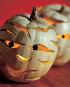 For a twist on a classic Jack-o'-Lantern, carve these creative mummy pumpkins. See how here: http://www.bhg.com/halloween/pumpkin-decorating/mr-mummy-pumpkin/?socsrc=bhgpin090312mummypumpkin