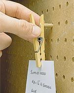 clothespin and pegboard-very small dowel? Drill, and wood glue? This could work!