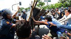 Philippine protesters clash with police in Manila slum riot