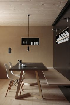 minimalist dining room. Love the bench and table