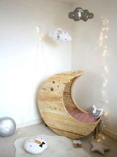 The rocking moon cot is just adorable and works particularly well with the addition of fairy lights, fur and the cute cloud mobile overhead.  It is a perfect illustration of a magical yet simplistic nursery for babies destined for the stars.