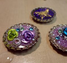 take a bottle cap and decorate!  poke a hole in the bottle cap and string it and it becomes a necklace or bracelet!