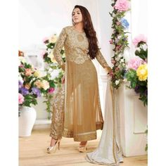 A very  stylish designer suit which is very similar to renowned fashion designer Manish Malhotra designed BROWN MIRROR WORK SARI . http://www.manishmalhotra.in/brown-mirror-work-sari-with-embroidered-blouse-6239.html