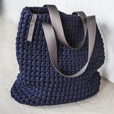 This is classic shape womans shoulder tote bag. It is made of recycled t-shirt yarn with synthetic or leather handles on your choice. Dimentions: 13X14 (33Х37 cm) The crochet bag is navy blue and the color of handles can be brown or black. There is also a possibility to attach the zipper lock. Please, choose the variations of handles and zipper! This is a very compact and yet capacious everyday womans bag for casual use. It can serve as a shopper bag too! The crochet chunky yarn allows it…